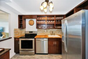 Open faced wood cabinets with stone backsplash in kitchen