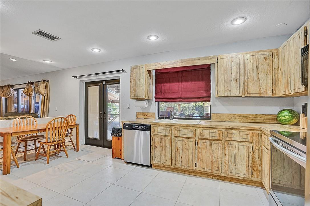 Lighting with Stainless Steel Appliances and Desk Area