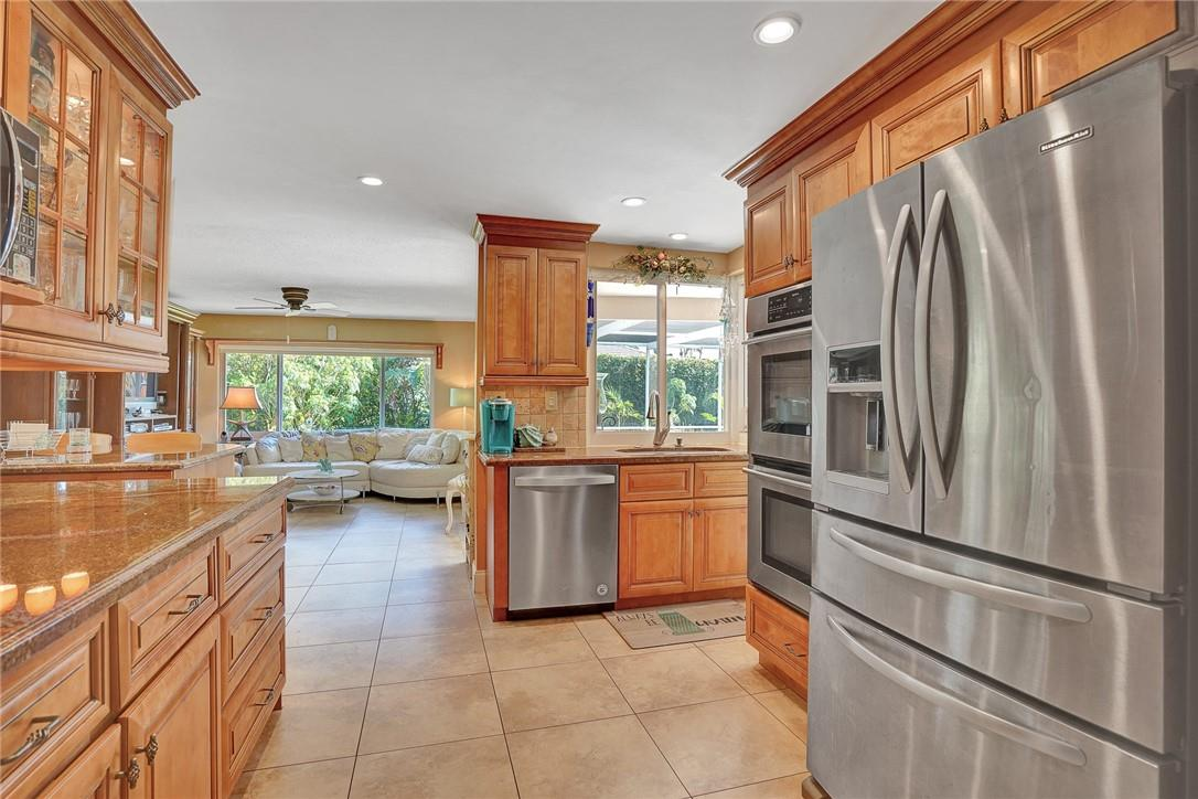 Large Open Kitchen Featuring Granite Countertops