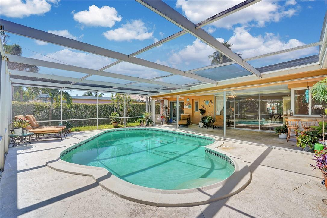 Pool with Covered Patio and Seating Area